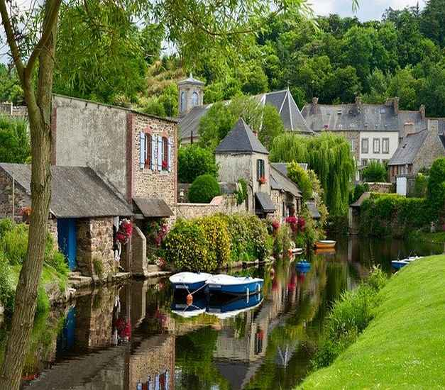 Photo of Pont Aven, town in Brittany, with houses and river
