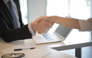 Starting a business in France shaking hands